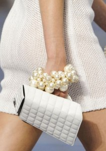 Go classic and trendy with a stunning pearl bracelet like this one from Chanel.
