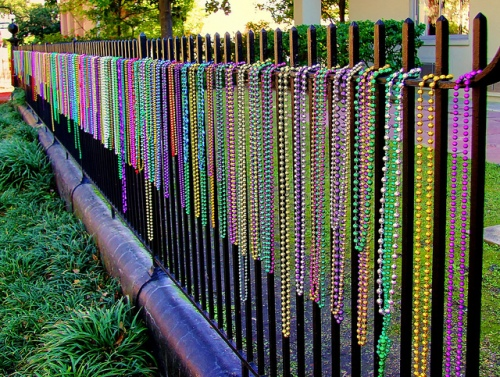mardi-gras-beads-on-fence
